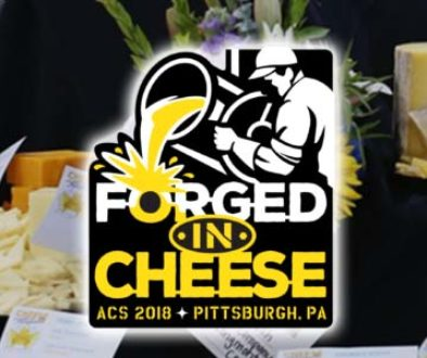 ACS 2018 logo on a photo background of cheeses.
