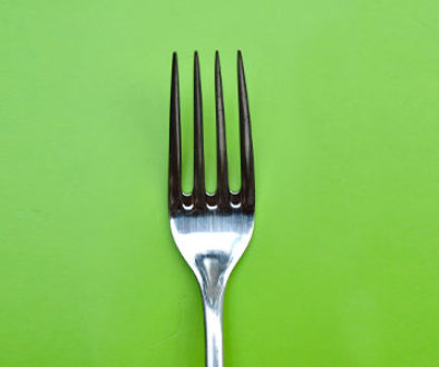 Fork on a green background.