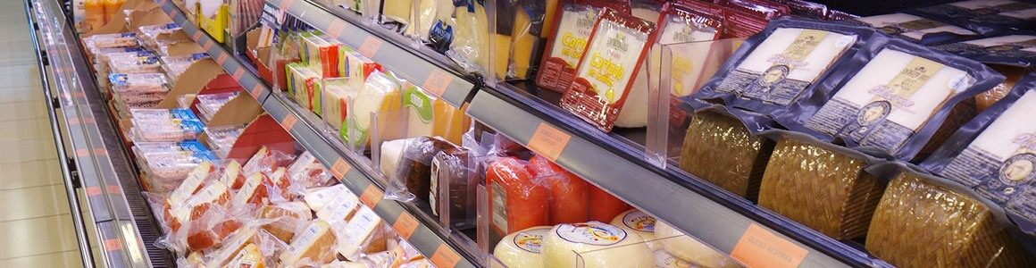 Dairy packaging products in a grocery store.