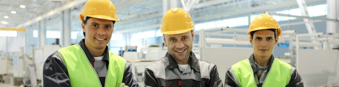Great workplace culture three happy manufacturing workers